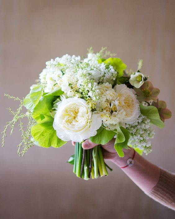 A stunning bouquet with acacia, geranium, Patience garden rose, narcissus, lilac and hellebore.