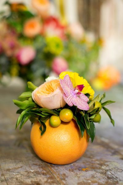 You don't need anything large to make an impact. This DIY flower arrangement in a hollow grapefruit is incredibly cute.