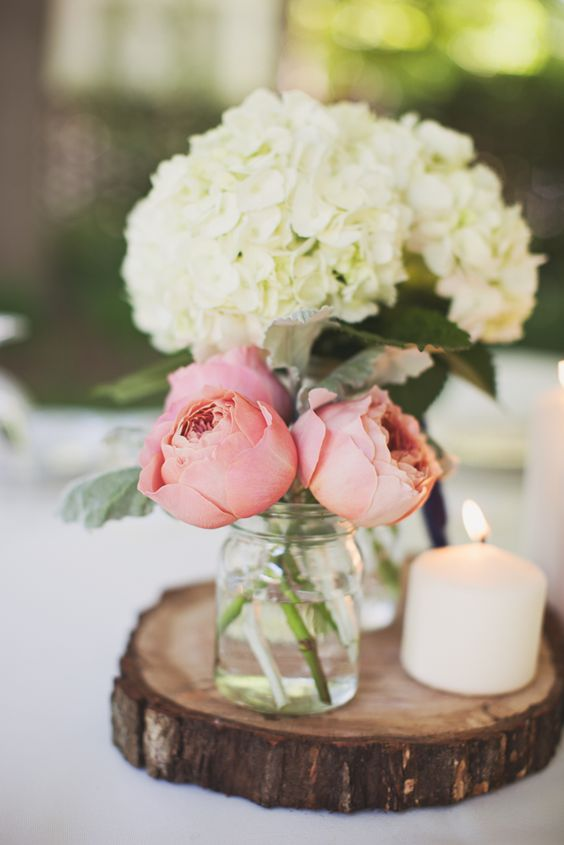 You can also stay on a budget. Fancy doesn't necessarily mean expensive. This sweet combination of mason jars, roses, hydrangeas and candles is easy to copy into your own home style.