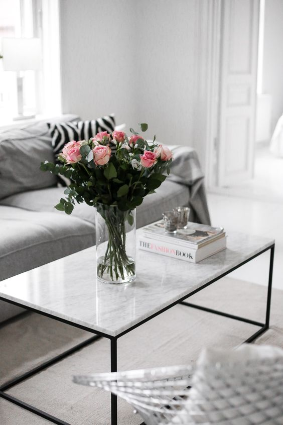grey home decor with vase of pink roses