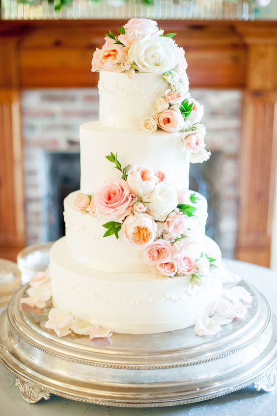Light floral cake for an elegant backyard wedding.