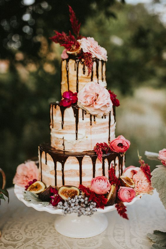 This gorgeous naked chocolate drizzle confection will make you drool! You should definitely check out the rest of the photoshoot. The theme used for this one is awesome!