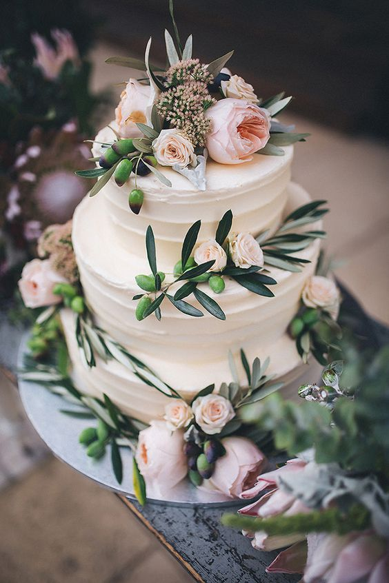 This cake with stunning Juliet roses was made for a silver and navy outdoor wedding.