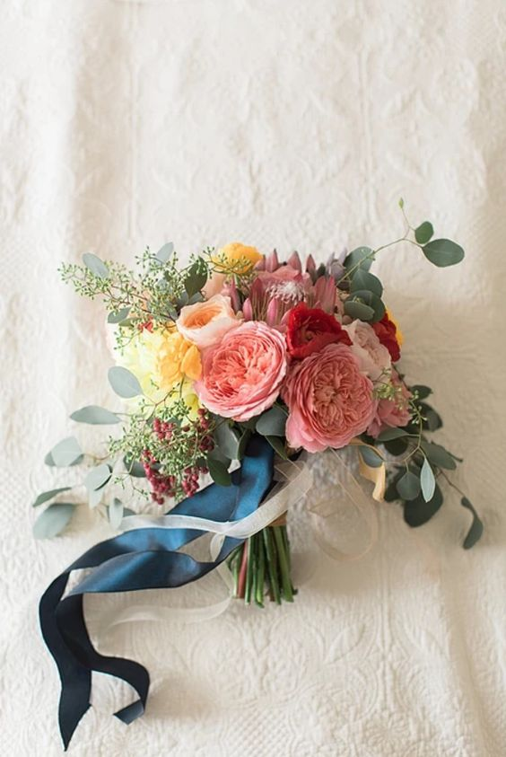 Loose greens, bright fluffy flowers and ocean blue ribbon - love it!