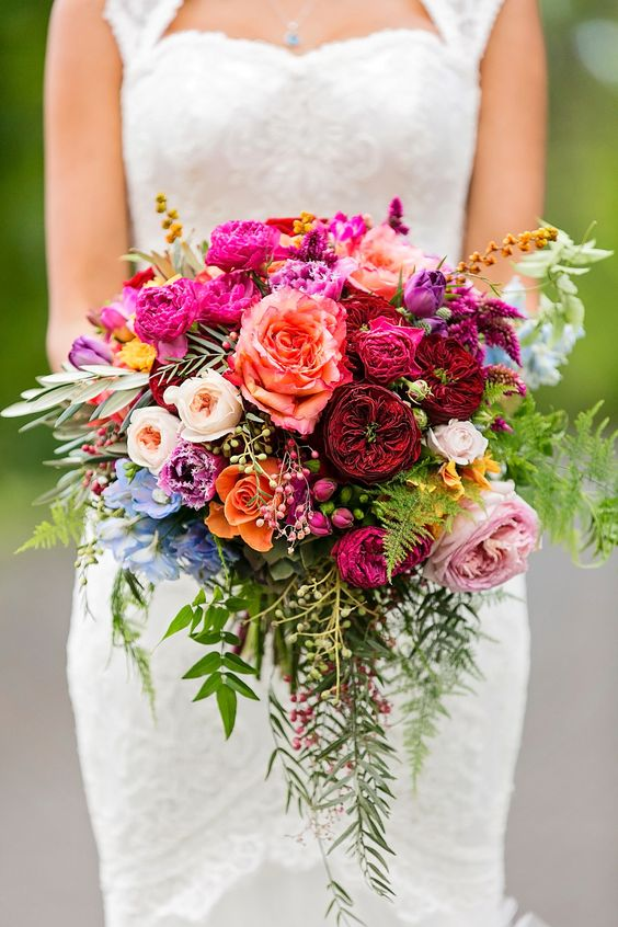 Can you spot the various David Austin varieties in this gorgeous and colorful bohemian wedding bouquet?