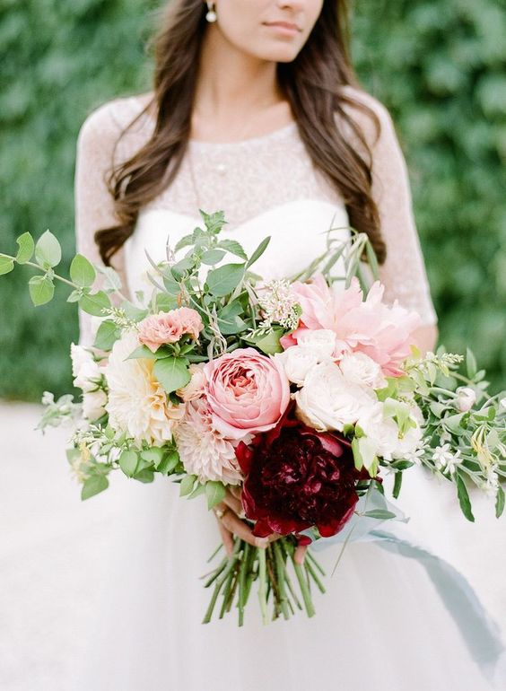 Soft Romantic Antike roses in this stunning wedding bouquet with just a hint of burgundy.