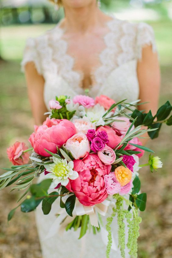 Charming pink bouquet featuring peonies, garden roses, spray roses, dahlias and ranunculus.