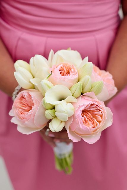 Another bridesmaid bouquet with peachy Julietgarden roses, white mini calla lilies and white tulips.