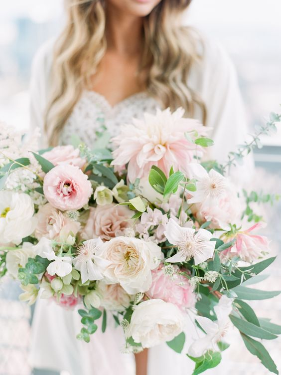 Overflowing dahlia and greenery wedding bouquet with white ruffled Patience roses.