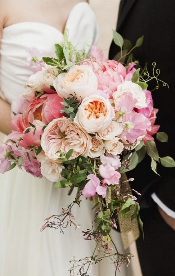 Beautiful combination of coral peonies, Juliet roses and Charity roses!