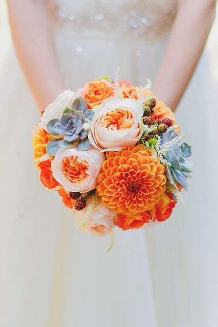 Teal, Turquoise and orange as a wedding colour combination is a bold, vibrant and pretty choice for beach wedding. This theme is bright,fun and cheerful.