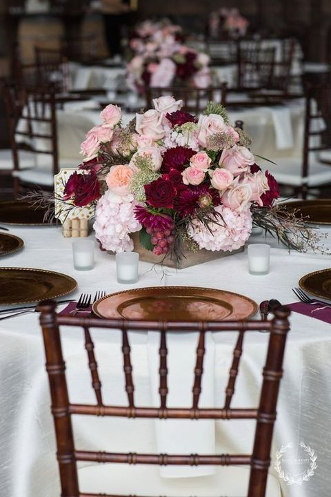 Refined burgundy and blush table decorations.