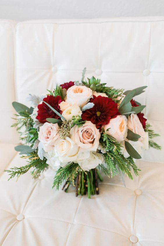 A burgundy/peach wedding bouquet with David Austin Juliet, dusty pink roses and burgundy Dahlia's.