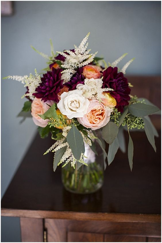 Burgundy, white and blush bouquet with a touch of orange.