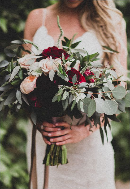 Romantic wedding bouquet with deep red roses and hints of peach.