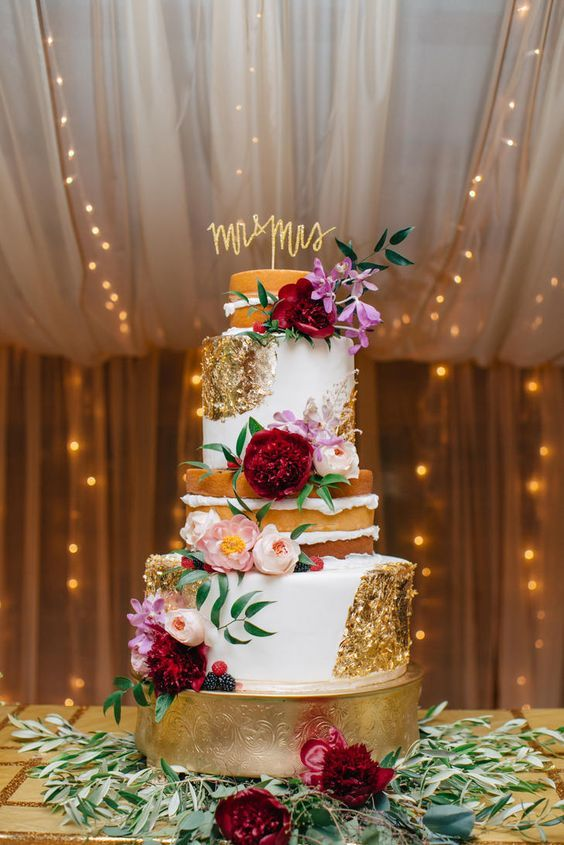 Half-naked, half-fondant cake dressed with gold foil, pink garden roses, marsala and pink peonies.