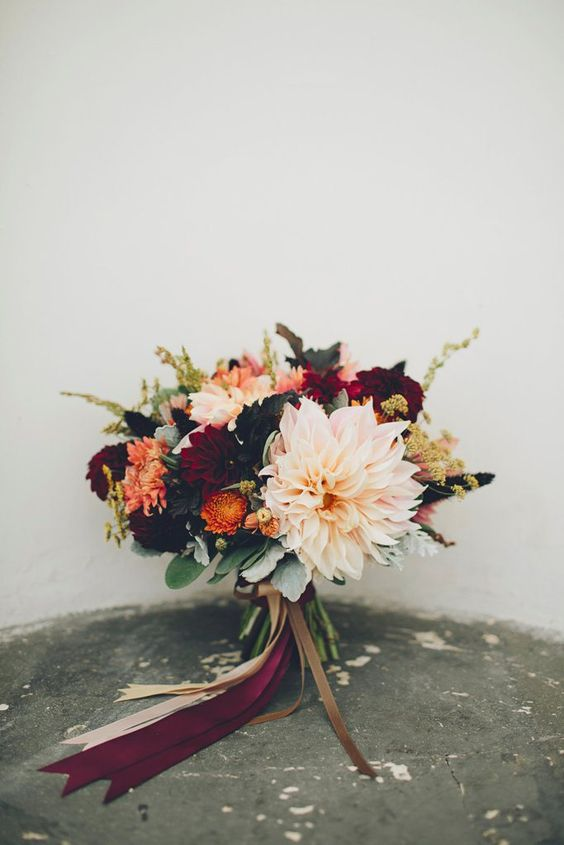 Dahlias. Hues of blush and wine with little bits of yellow and orange.