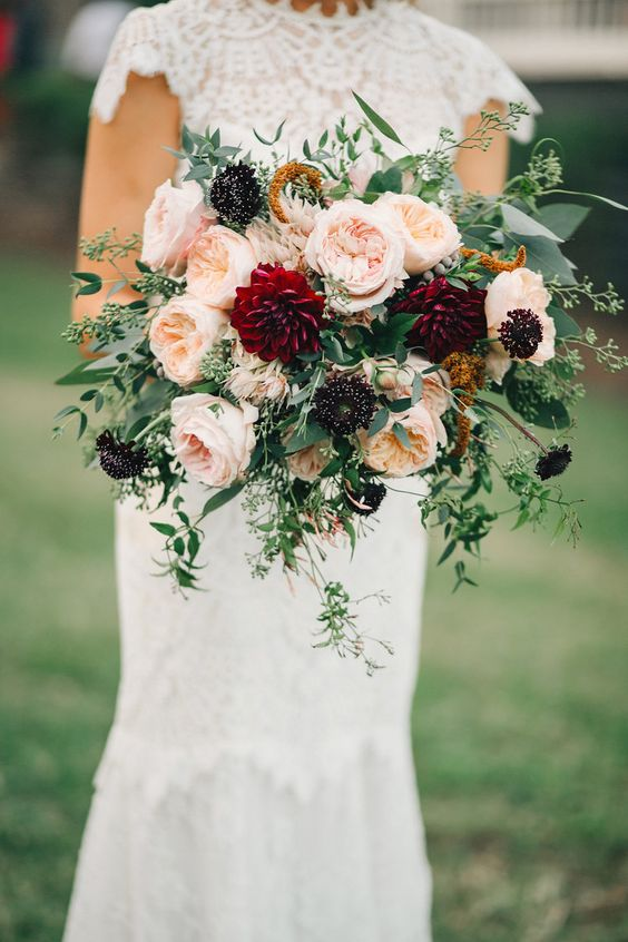 Lush, organic bridal bouquet with burgundy dahlias, peach Juliet garden roses, and trailing greenery.