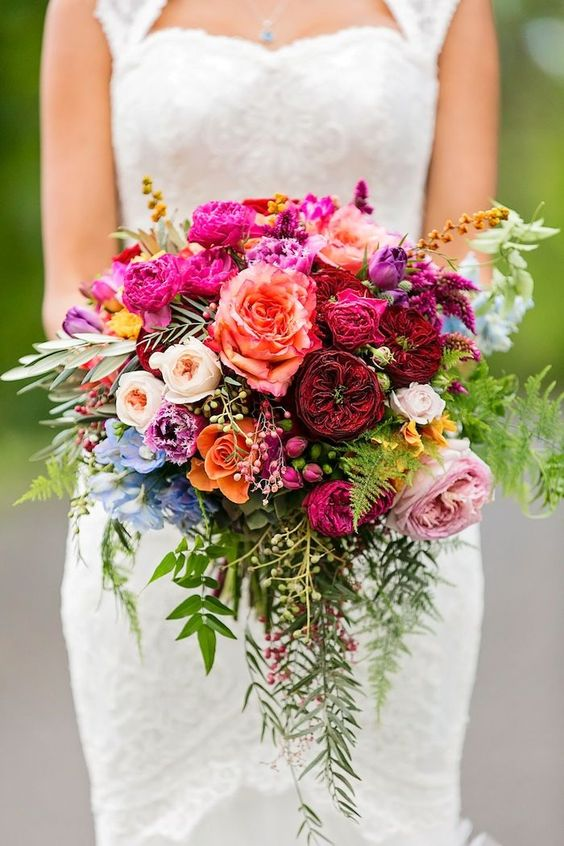 Dare to add some color this fall! The unexpected combination of 'Juliet', 'Tess' and 'Free Spirit' roses works extremely well in this bold and bright bouquet.