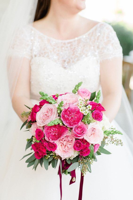 A classic combination of different shades of pink never goes out of style. Via Hey Wedding Lady
