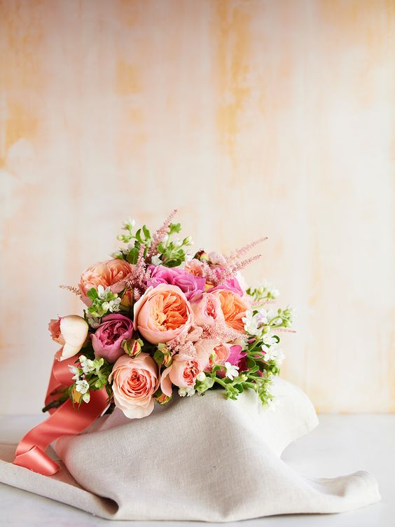 Stunning bouquet in candy pink and peach colors. Via Once Wed