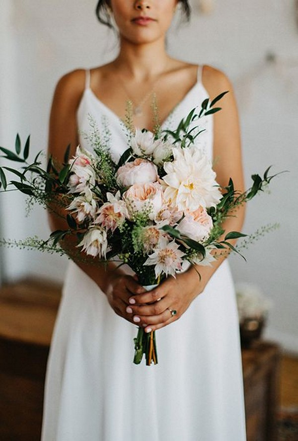 Beautiful and elegant wedding bouquet with Juliet roses. Via Oh Best Day Ever