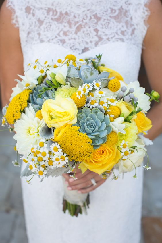 Yellow succulent bridal bouquet with succulents, chamomile, billy balls, dusty miller, dahlias, ranunculus, yarrow, and, of course, roses. Via Florals by Jenny