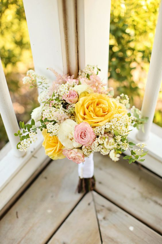 The combination of soft yellow and soft pink makes this a sweet and summery bridesmaid bouquet. Via Wedding Chicks