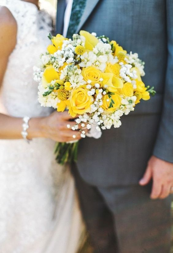 Bridal bouquet with yellow roses, calla lilies, craspedia,  and queen anne's lace.