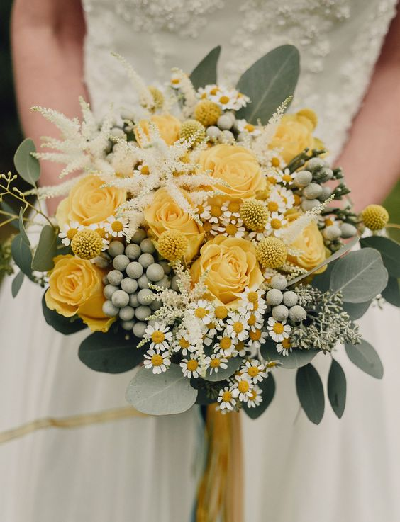 Bouquet with yellow roses that has an autumn sort of feel to it. Via Green Wedding Shoes