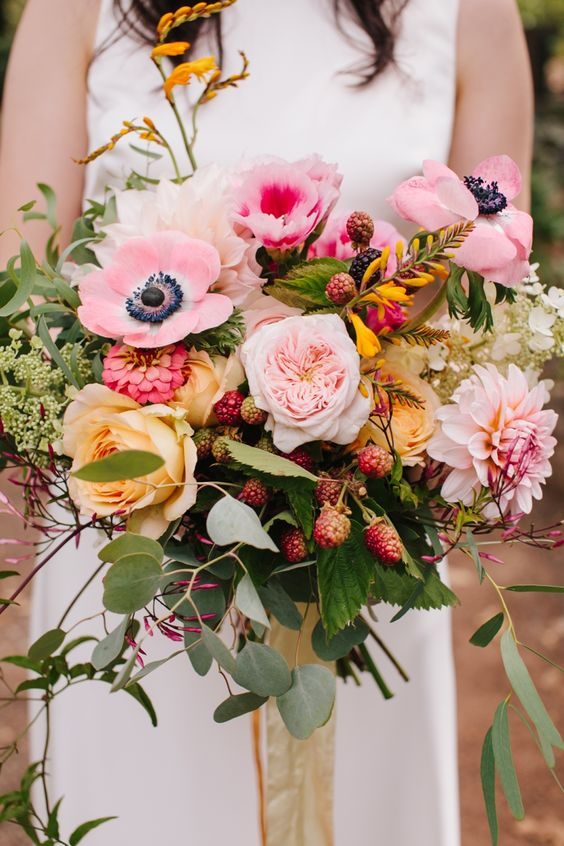 Beautiful and intimate wedding bouquet with the softest shades of pink and yellow. Via Simone Anne