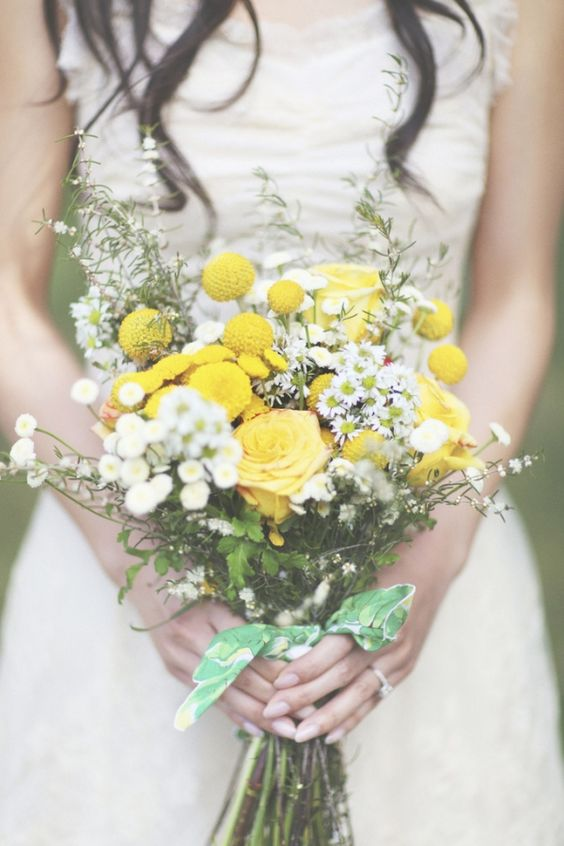 Sunny wedding bouquet with billy button, yellow roses, and white aster. Via Ruffled Blog