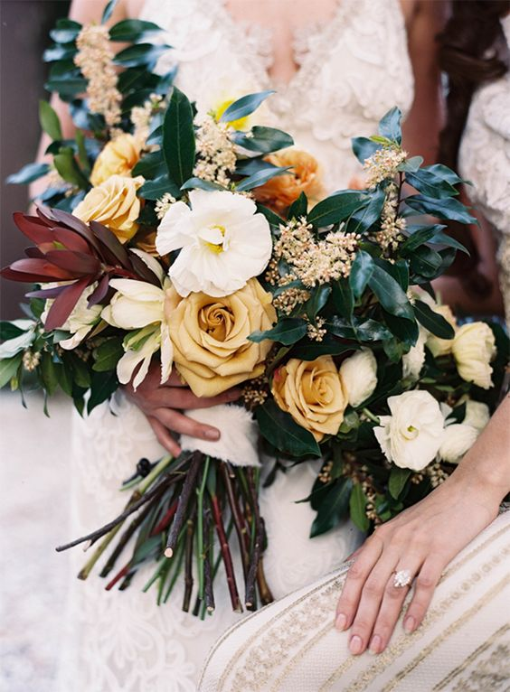 Mustard yellow roses make up for a pretty stunning rustic wedding bouquet! Via Once Wed