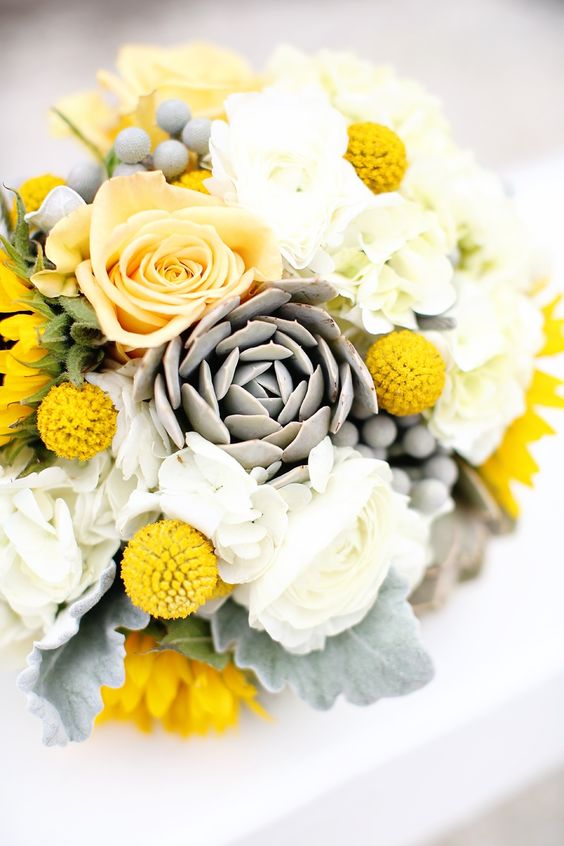 Bold and brilliant wedding bouquet with yellow roses. Via MOD Wedding