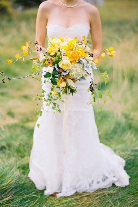 Summer vibes all over with this stunning bouquet with yellow roses. Via Studio Choo Florists