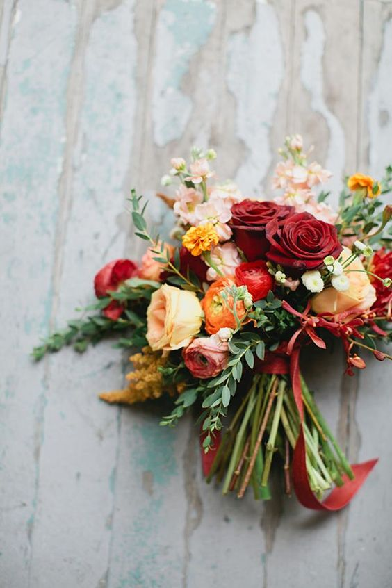 Bold bouquet with red and yellow roses. Via Wedding Party