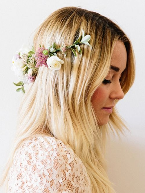 If there anyone who knows how to rock a floral hairstyle, it's Lauren Conrad. Via Elle