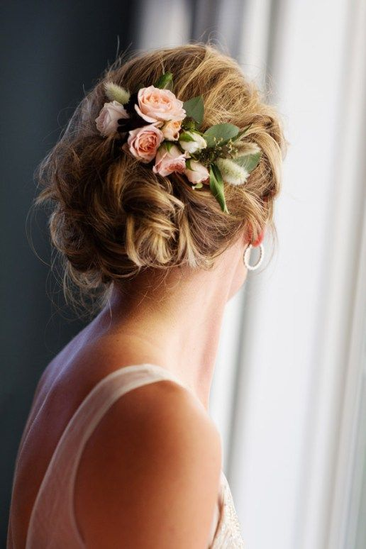 Blush flowers and leaves for a cool twisted wedding updo. Via Weddingomania