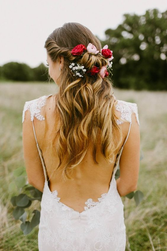 Half up, soft curls and pretty flowers. Via Junebug Weddings