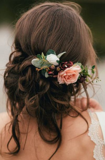 If you want your florals to be a more subtle complement to your look, a flower comb is the perfect accessory to your outfit. Via Lovely Clusters