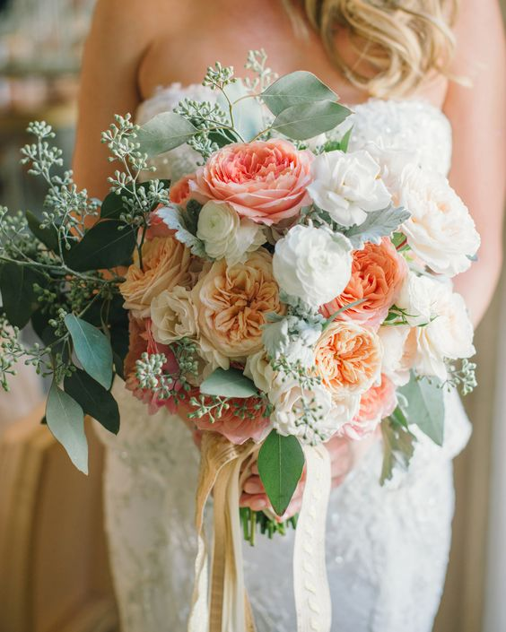 Lush peach/coral wedding bouquet with roses