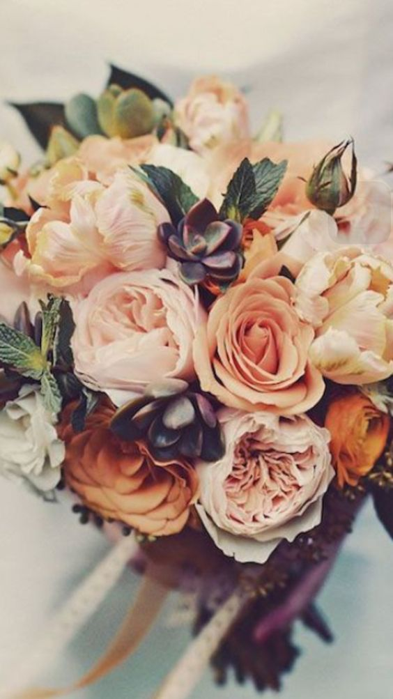 Fall wedding bouquet with soft orange and peach colors