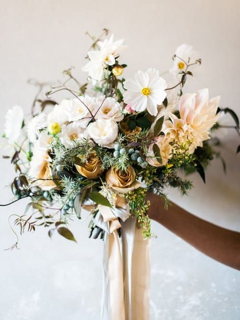 Cream and mustard colored wedding bouquet