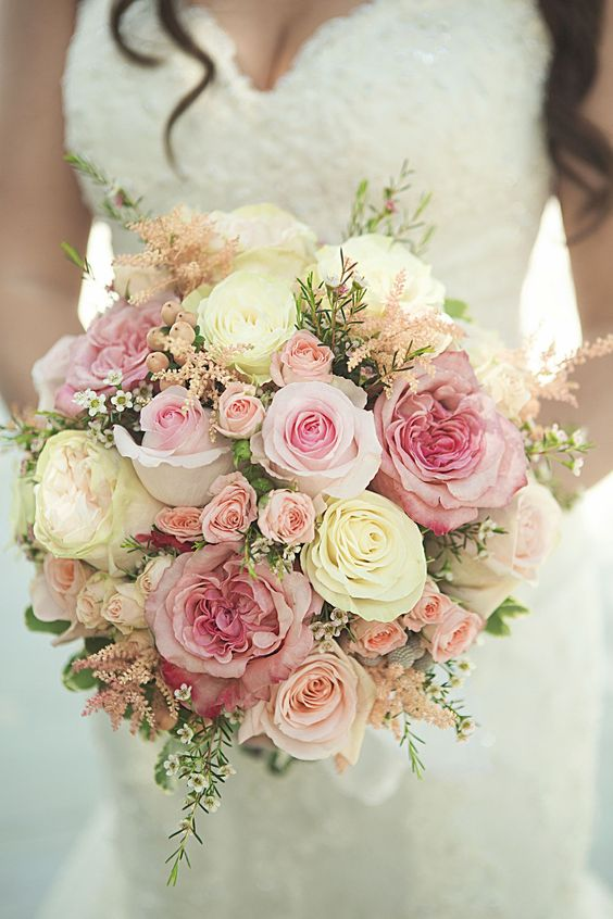 Whites and pinks wedding bouquet. Via Living Wedding