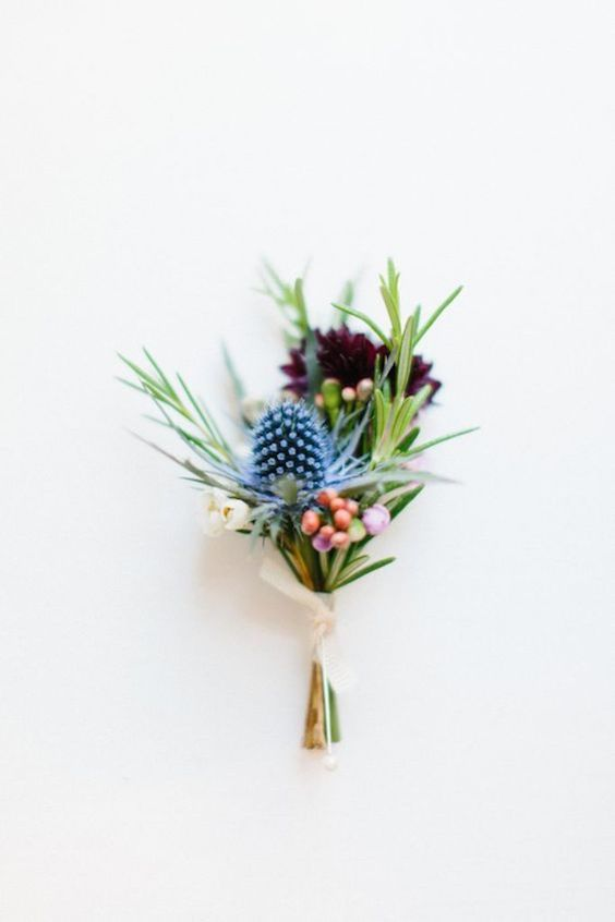 Tropical flower boutonniere. Via Bodas Y Weddings.