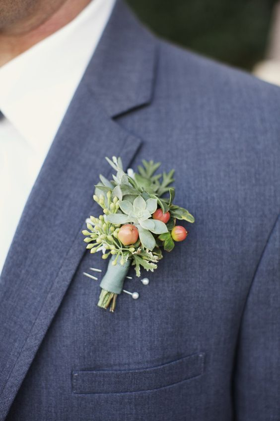 Floral boutonniere with succulents. Via Ruffled Blog.