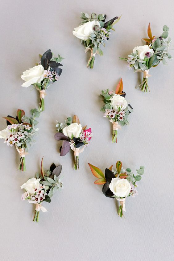 Wedding boutonnieres that look like tiny bouquets. Via Style Me Pretty
