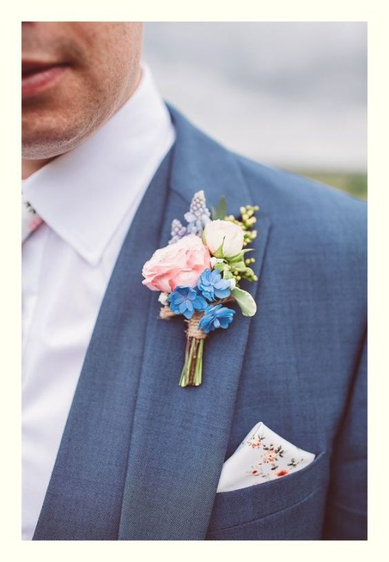 Floral boutonnieres. Via Fine Weddings