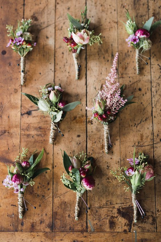 Gorgeous floral boutonnieres that look like tiny bouquets. Via Style Me Pretty