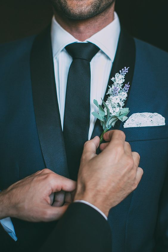 Wedding boutonniere with flowers. Via The Wedding Playbook